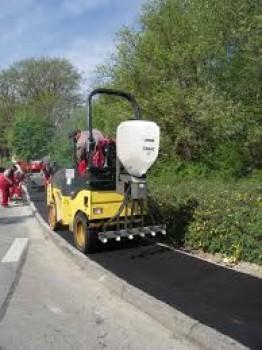 Dispozitiv imprastiere granule pentru constructii drumuri